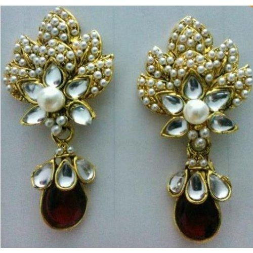 Great design from Advaita with red stones, kundan and pearl