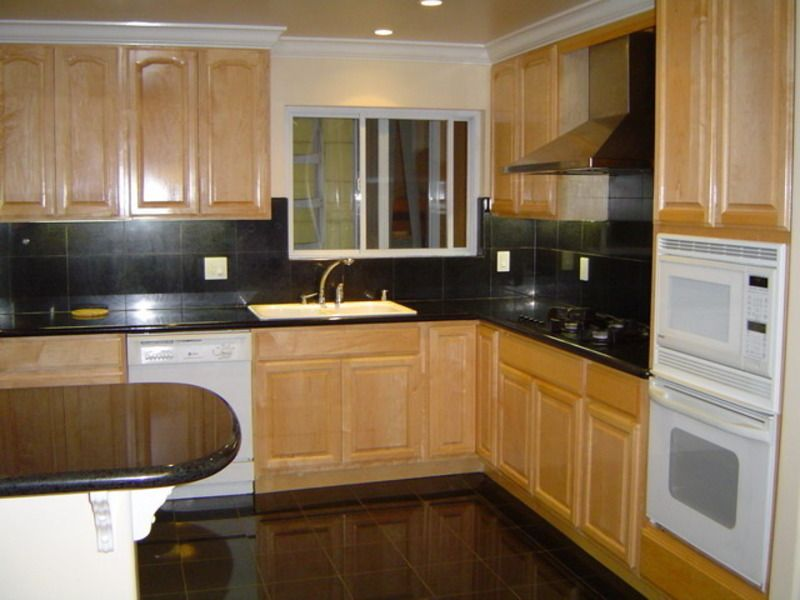 Black counter looks nice but not with white appliances for Cherry kitchen cabinets with white appliances