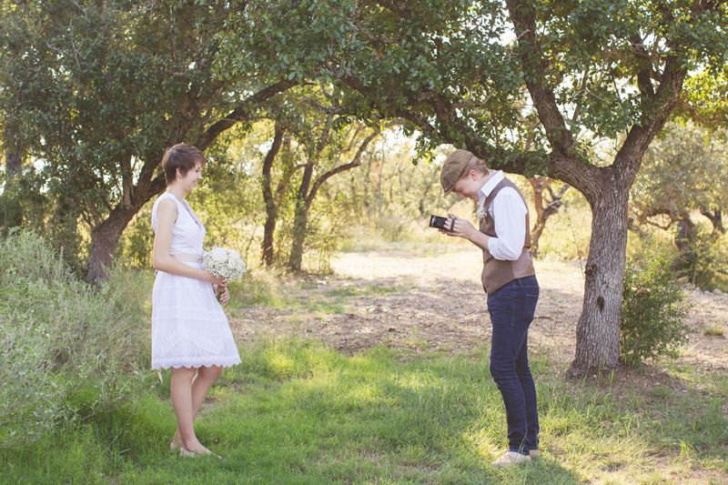 Vista West Ranch Wedding, bride and groom portraits, fun wedding photography, natural light, rustic wedding, barn wedding, austin wedding photography, short wedding dress, newsboy cap, vintage camera, bridal bouquet, white roses, baby's breath, photojournalist, documentary photography