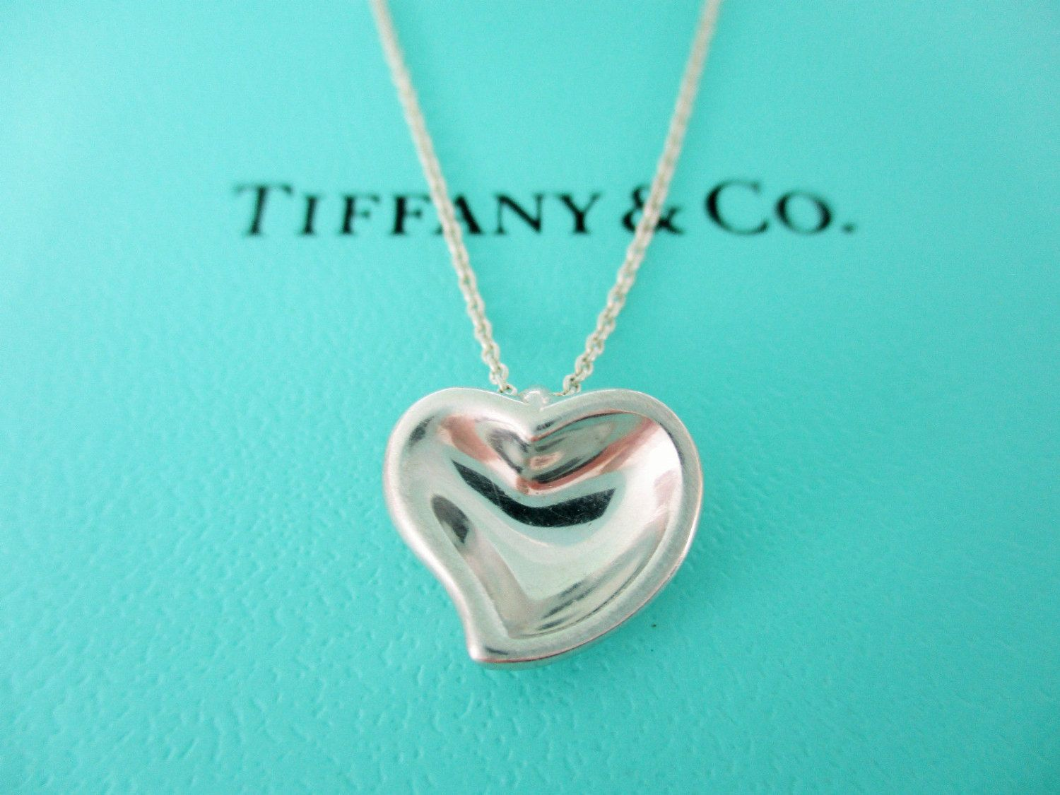 55450c14c Lovely Tiffany & Co. Sterling Silver Small Curved Full Heart Designed by  Elsa Peretti and comes from Spain by Tiffanytreasureshop on Etsy