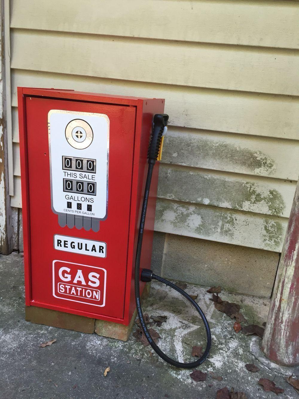 Toy gas pump from an old closet maid shelf, garden hose