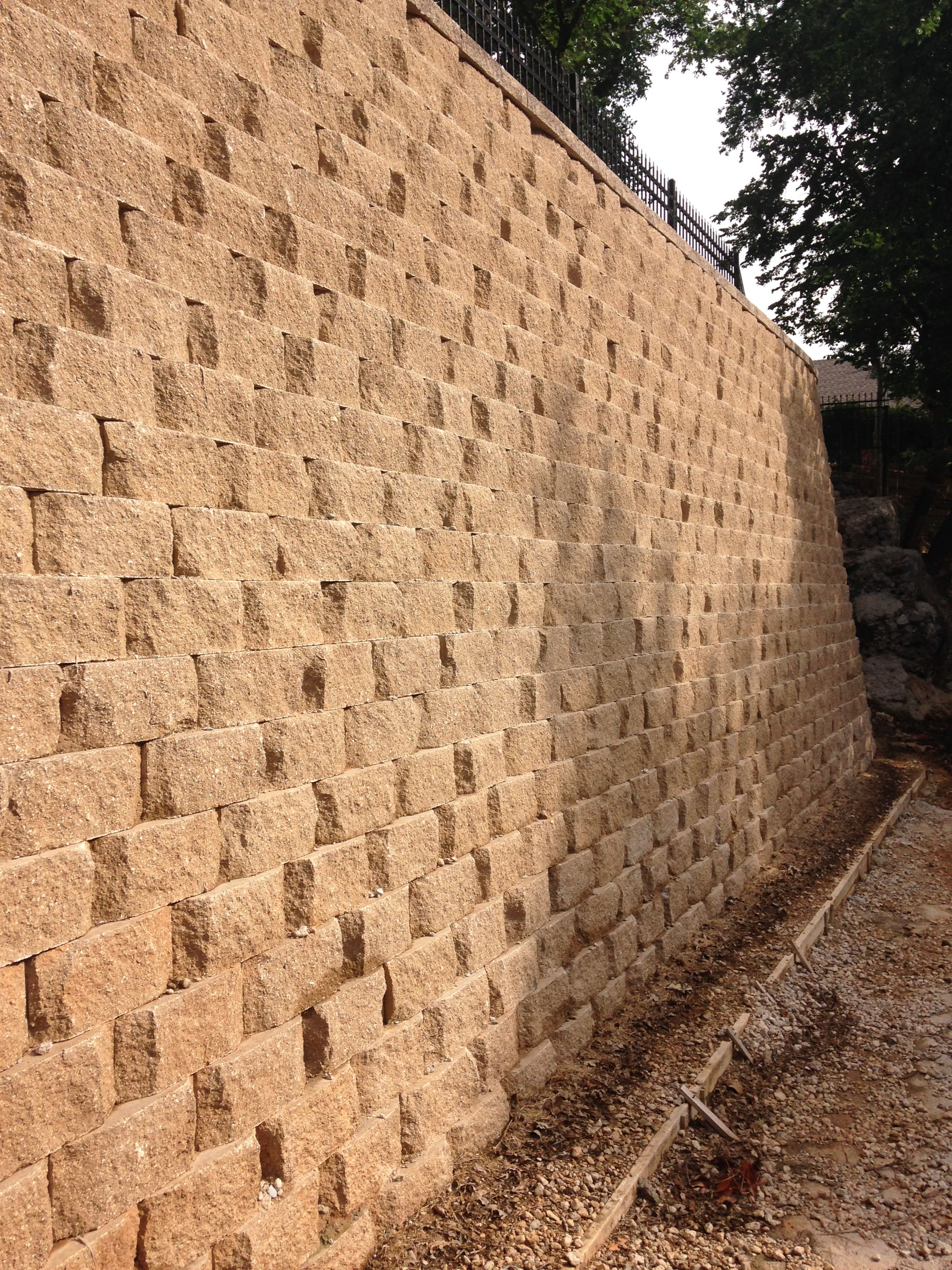 During Heavy Rains This 12 Retaining Wall Has 2 Feet Of Extra Height This Wall Has Endured 2 100 Year Rain Event Landscape Design Hardscape Retaining Wall