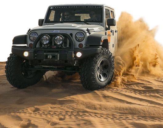 HEMI powered Jeep Wrangler Unlimited (JK) chugging through the sand.
