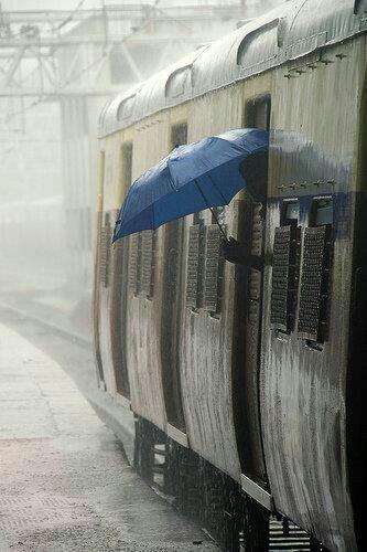 Rain I love the pop of color of the blue umbrella