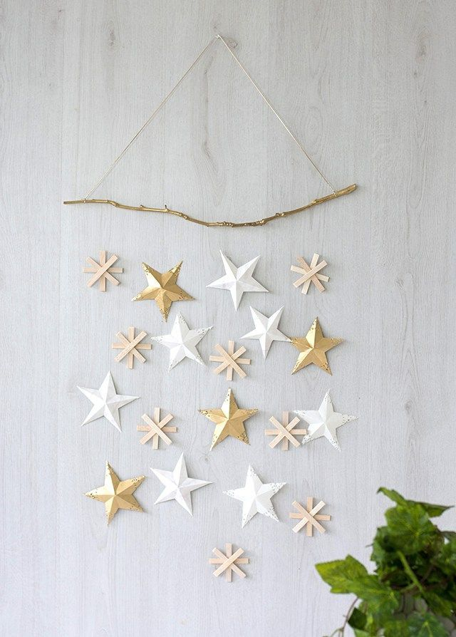 This DIY Project Is Simple And Easy To Make, But Also Incredibly On Trend.  Craft Hunter Blog DIY Christmas Stars Wall Hanging.
