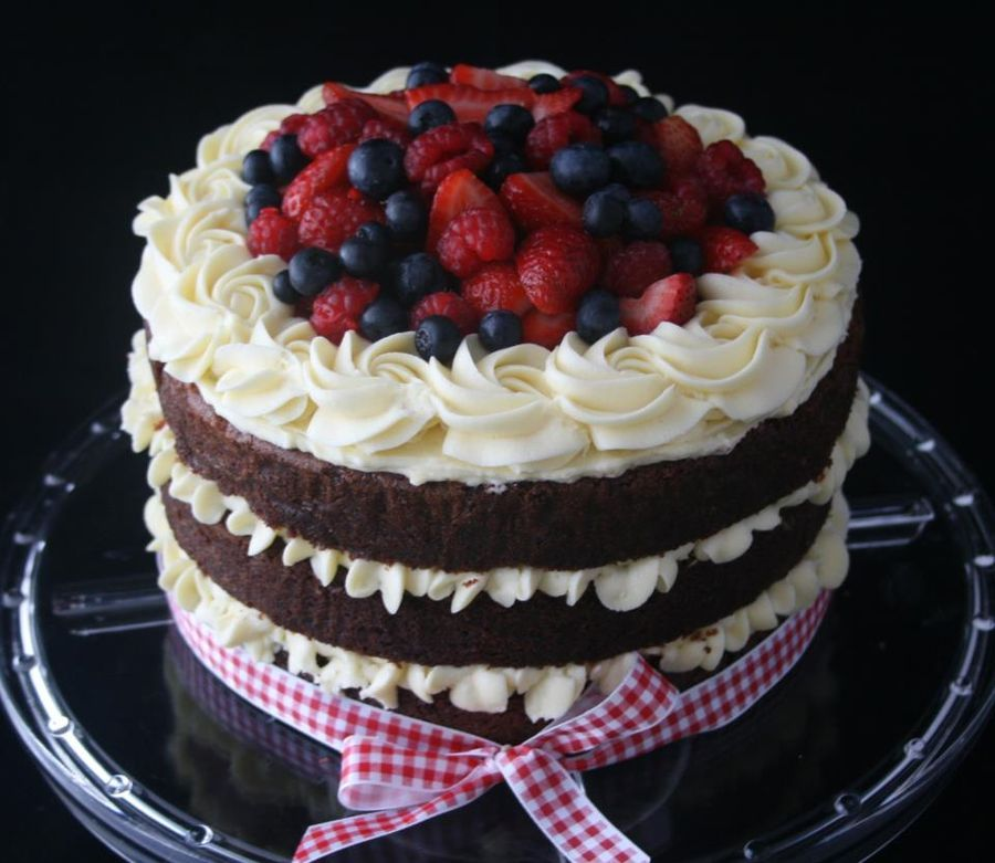 Red velvet cake with cream cheese frosting topped with ...
