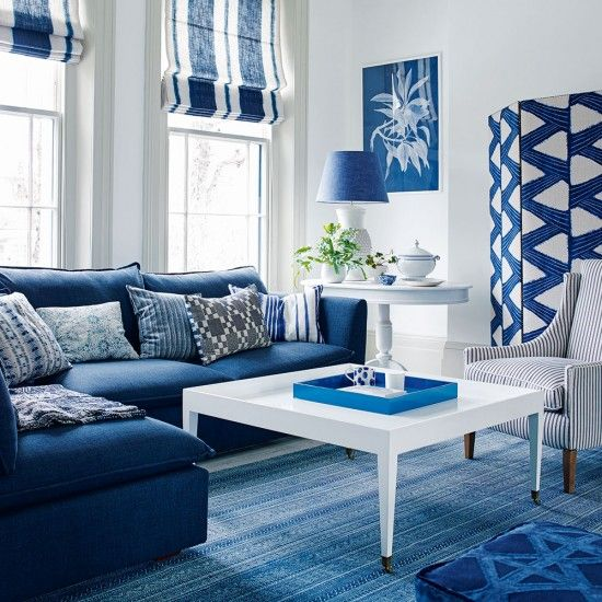 Blue And White Living Room With Cobalt Blue Sofa And Striped Blinds Ideal Home White Living Room Decor Blue Living Room Decor Blue Living Room