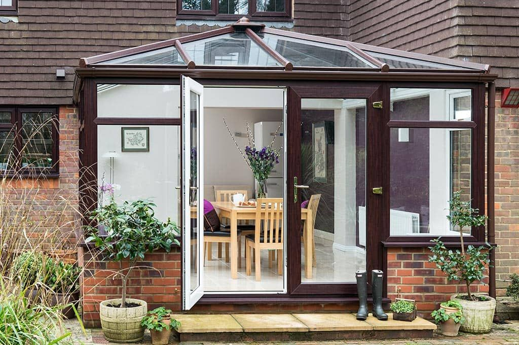 Everest Upvc Conservatory With Gold Handles From An Outside View Cheap Conservatory Conservatory New Homes