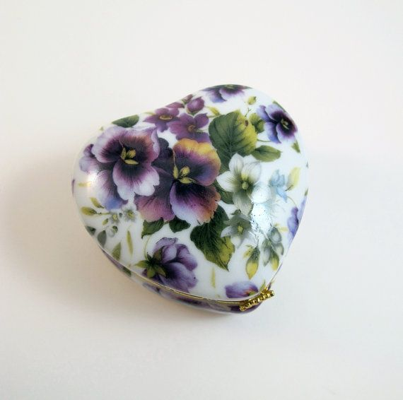 A little heart porcelaine trinket box covered with painted pansies. $10.00, via Etsy.