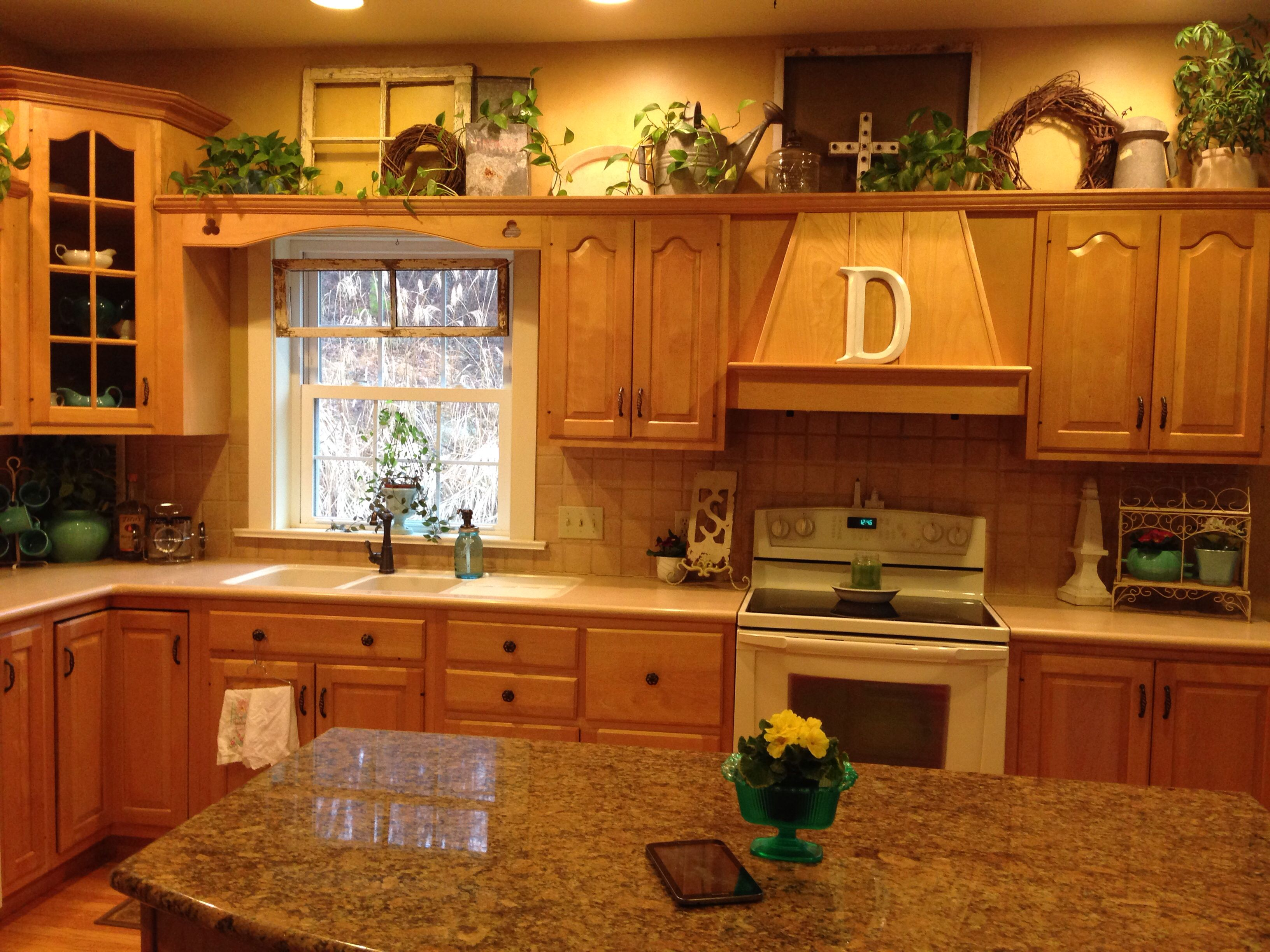 Springtime kitchen decor using vintage items.Above the cabinets I ...