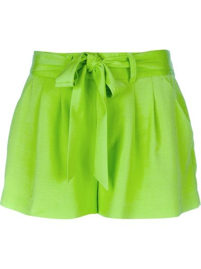 Belted shorts in neon green by Alice + Olivia.