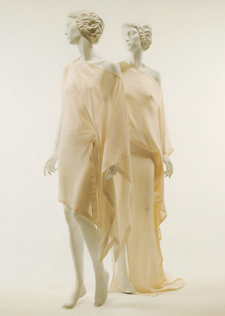 Donna Karan 2002  This reminds me of the Mesopotamian garment made from a rectangle of fabric wrapped around the body like the deities also called kaunakes 2500-1000 B.C. because of the way the sleeve drapes, it separates it from being greek, its more simple and hangs around arm.