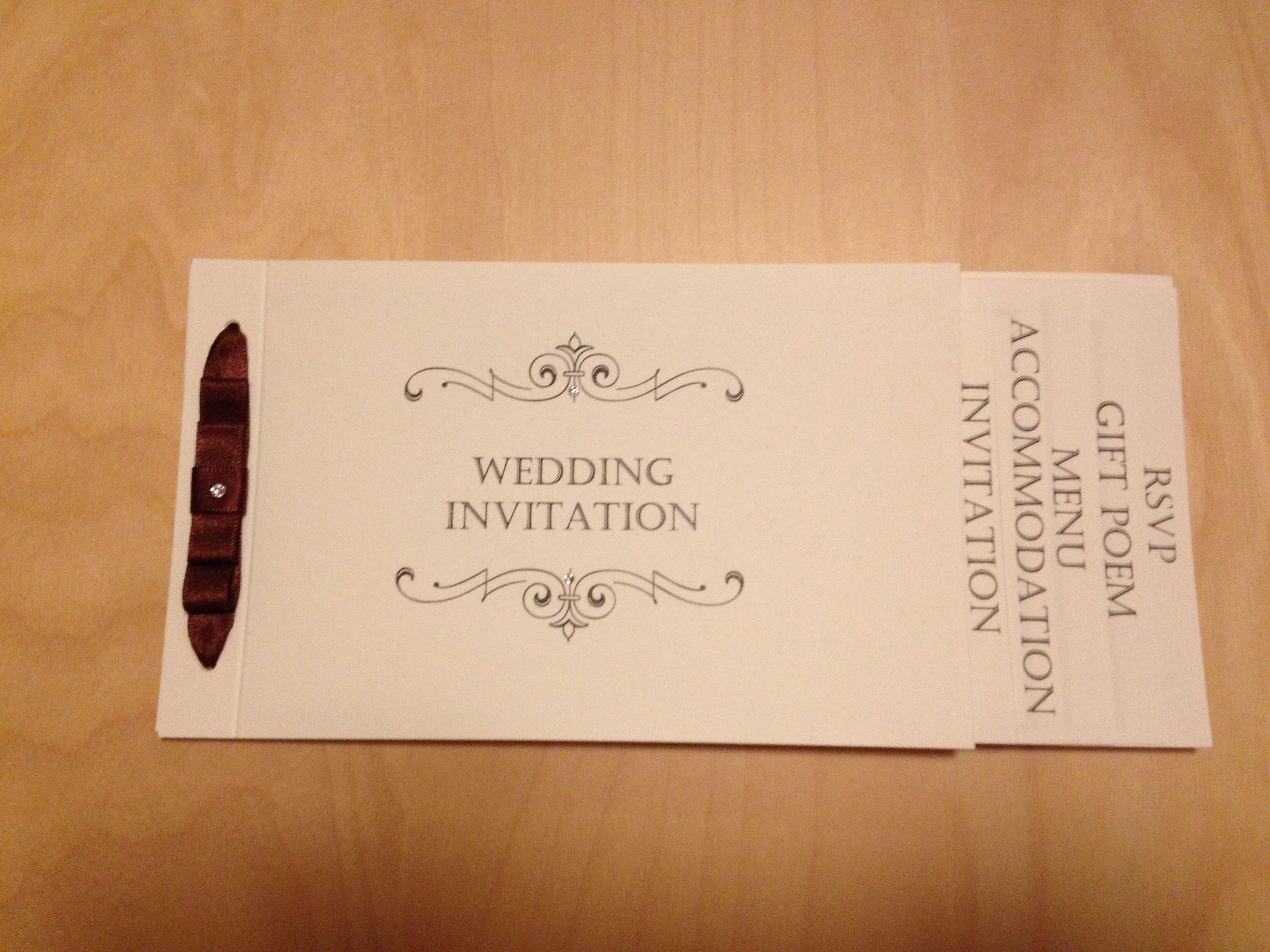 Classical cheque book wedding invitation from ttlehwithlove