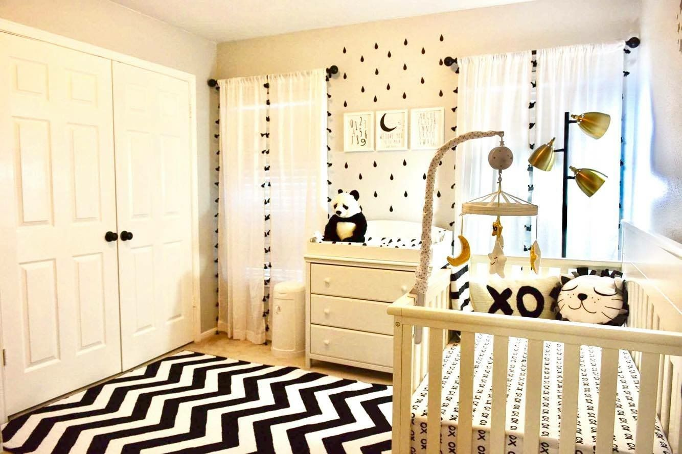 Black &white nursery with slight touch of gold. Literally, took long to deck this room. But, it was worth it.