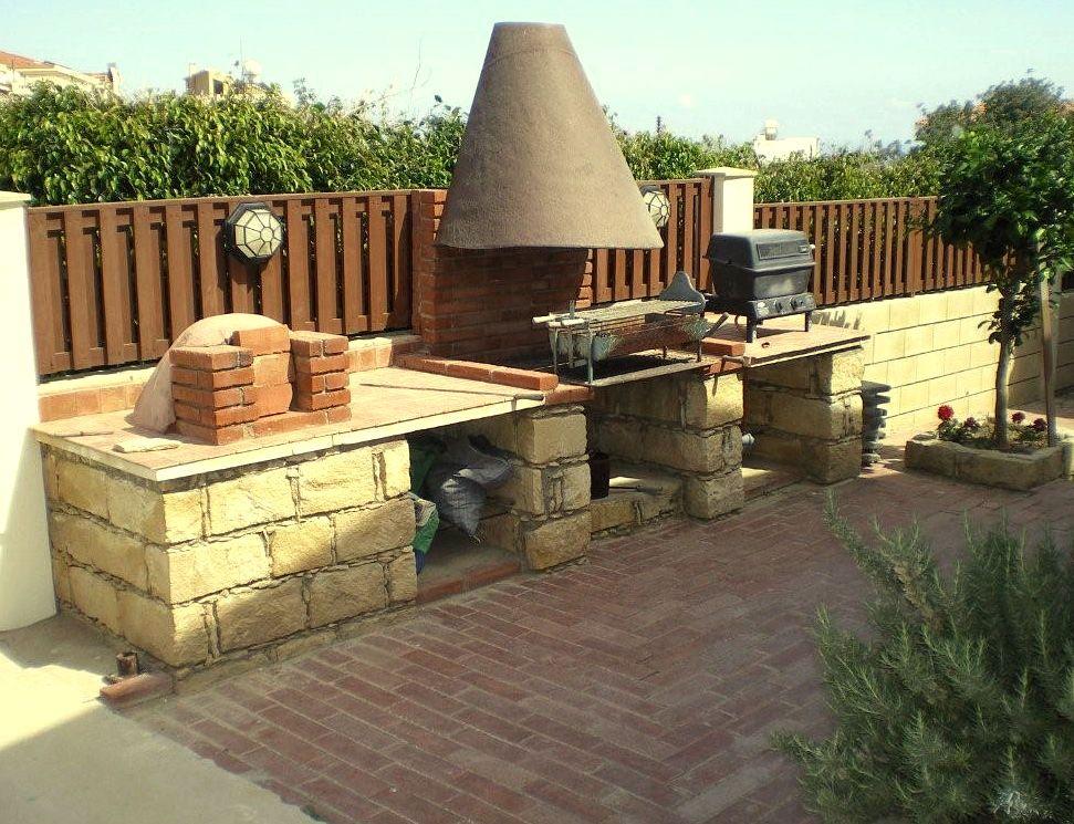 Cocina y asador en el exterior decoracion del hogar for Cocinas rusticas para patios