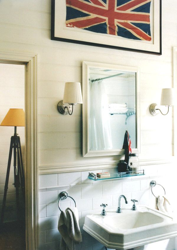 I like the square pedestal sink, lights and artwork in this bathroom