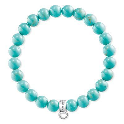 With beads crafted from imitation turquoise, this THOMAS SABO Charm Club bracelet colourfully envelops the wrist of its wearer, bringing a particular radiance to all skin tones.