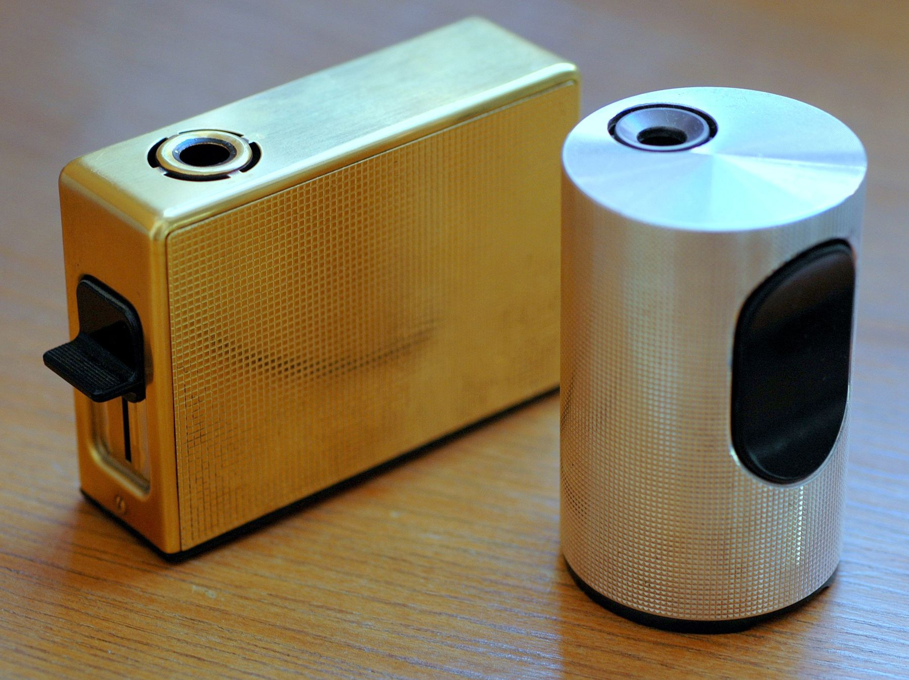 Braun luxury - a silver-plated T 2 table lighter (Dieter Rams, 1968), with a gold-plated TFG 1 (Reinhold Weiss, 1965)