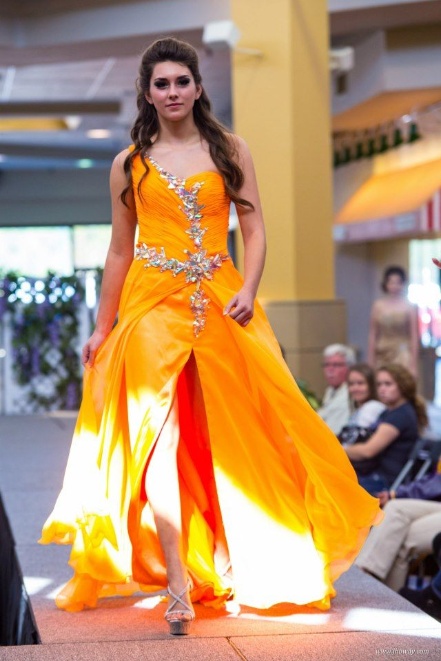 Emily rocking this neon orange dress by Partytime Formals!