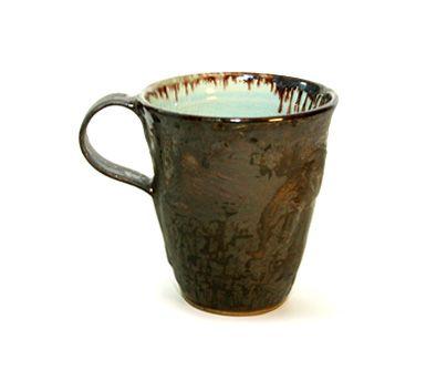 Alice Goldsmith coffee mug.