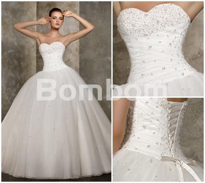 vestido de boda princesa blanco corpiño bordado con pedreria escote