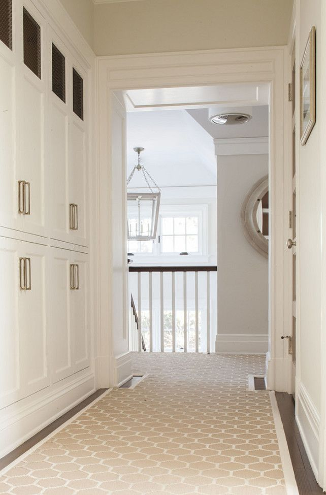 Elegant Hallway With Built In White Linen Closets Accented With Nickel  Hardware Over Dark Hardwood Floors Layered With A Custom Beige And Ivory  Geometric ...