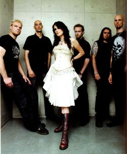 Within Temptation - Hard rock sound with female singer. They sound a little like Evanescence, but with a symphonic sound.