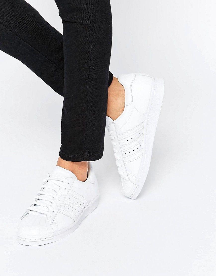 huge selection of 0c881 e271f Zapatillas de deporte blancas con puntera perla metalizada Superstar de  adidas. Zapatillas de deporte de Adidas, Exterior de cuero, Cierre de  cordones, ...