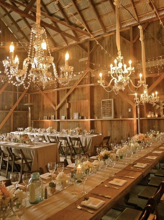 I love the chandeliers that are hung by fabric and staggered in length. This is simple elegance in a barn! barn-wedding-reception