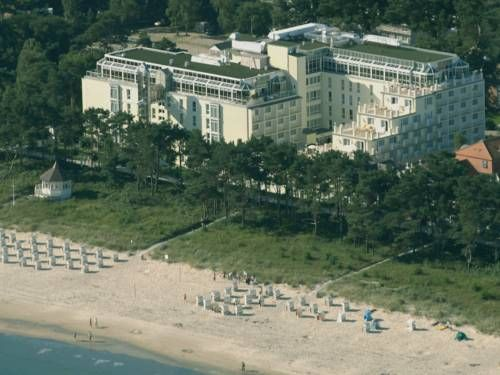 Rugard Strandhotel Ostseebad Binz Overlooking Binz's sandy beach on the island of Rügen, this 4-star-Superior hotel offers elegant rooms, a large spa area with a saltwater pool and free WiFi in all areas. This hotel is managed by Private Palace Hotels & Resorts.