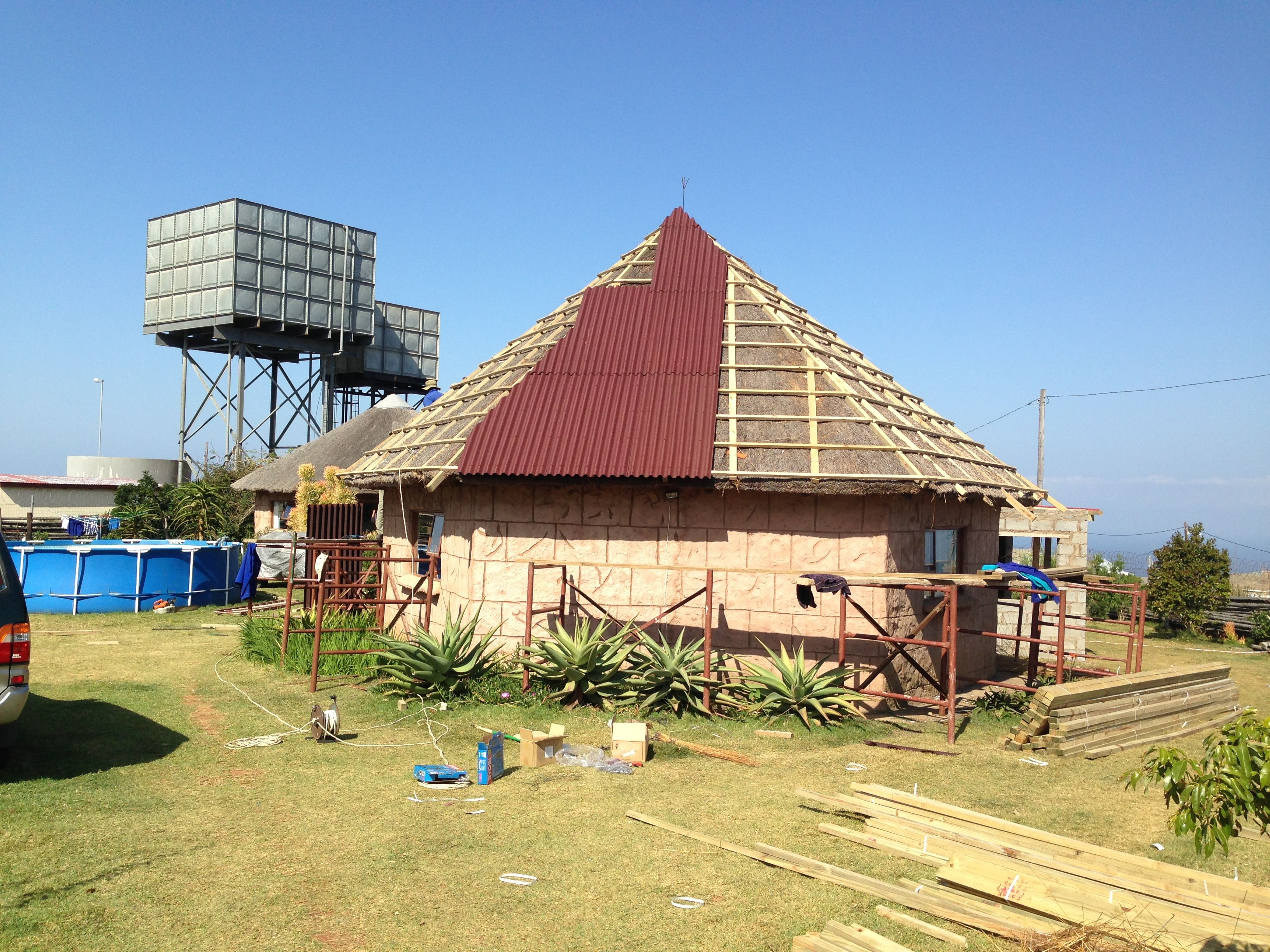 An Eastern Cape Hospital Thatched Roof Being Converted To Onduline Roofing With The Over Sheeting Method Building Plans House Timber House Roofing