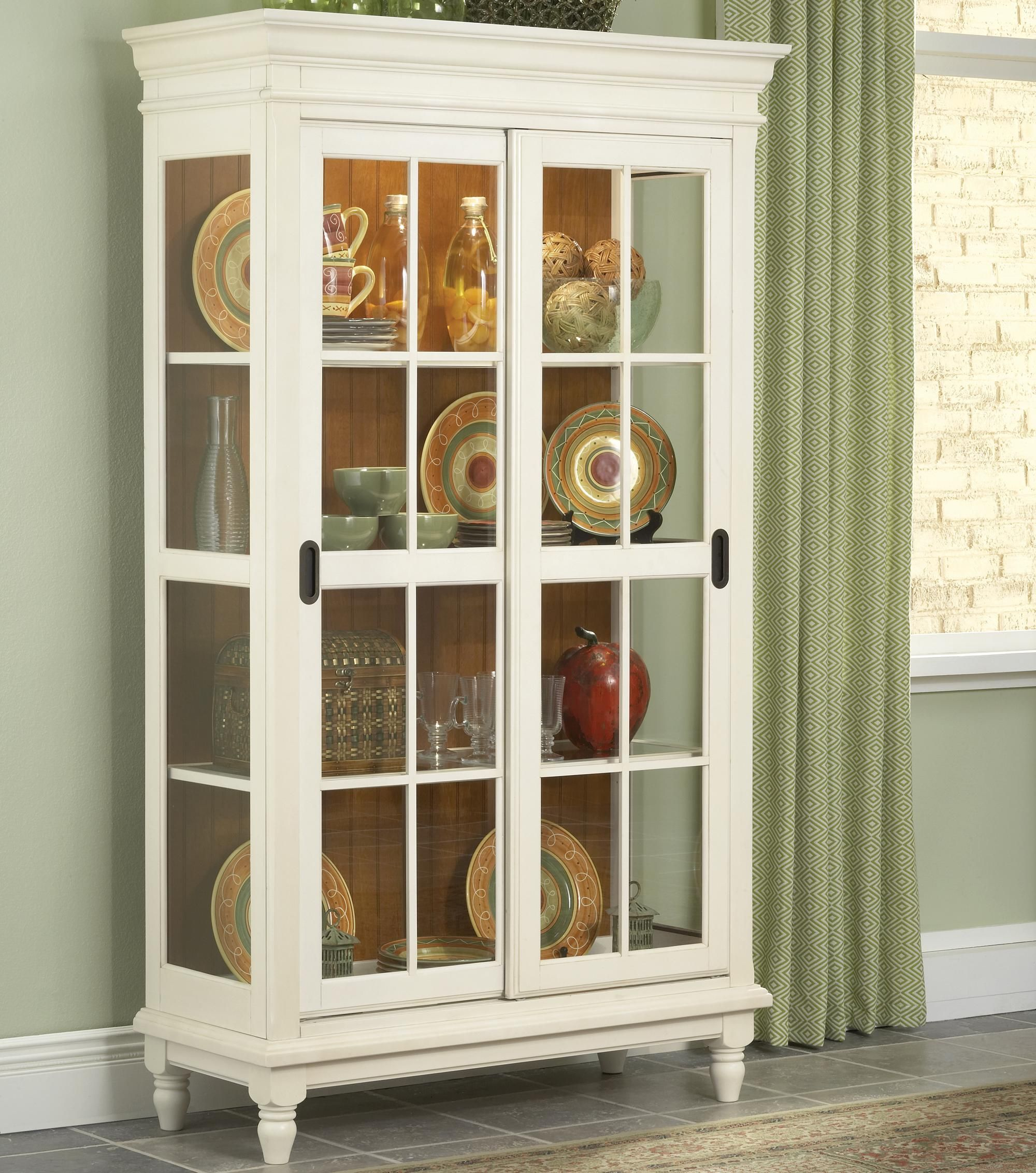 Dining Room Pieces Curio Cabinet With Crown Moulding, Turned Feet, And  Sliding Glass Doors