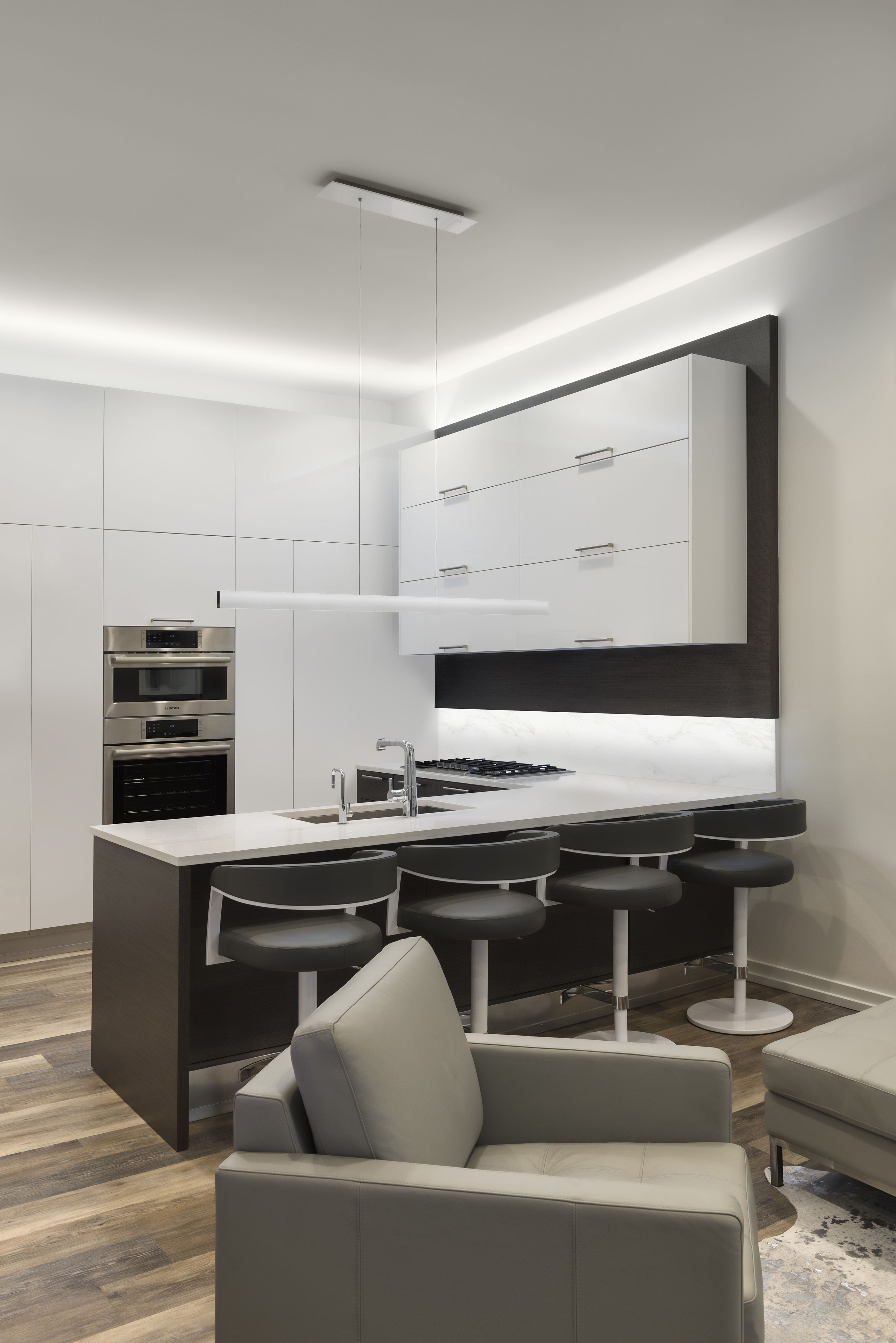 Adding to the clean, modern decor, this linear suspension projects ...
