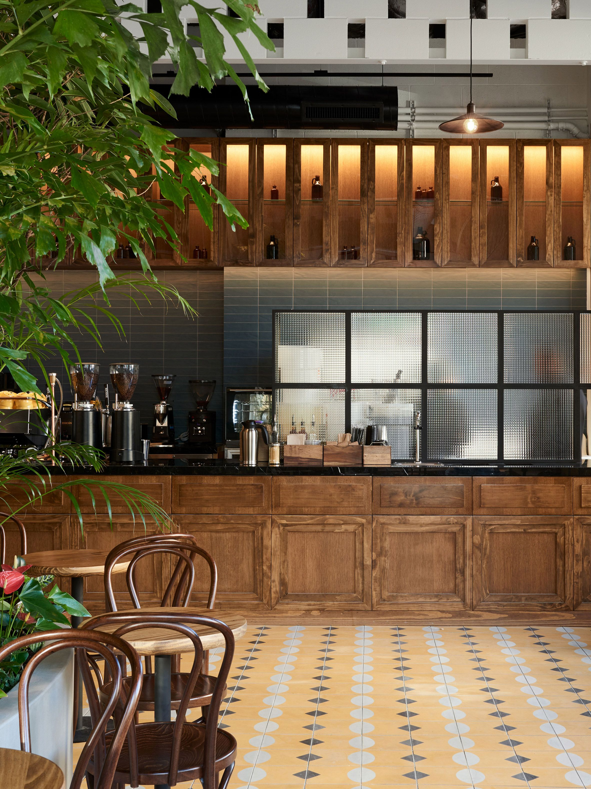 LOT creates tropical garden within Brooklyn coffee house