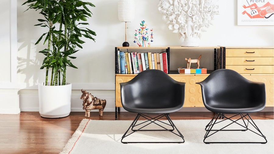 Two Eames Molded Plastic Armchairs With Low Wire Bases On A Rug In A L In 2020 Latest Furniture Designs Contemporary Living Room Furniture Modern Furniture Living Room