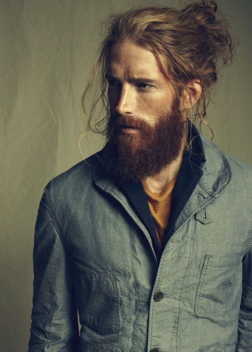 Up do and a beard. Masculine and feminine at the same time. Stunning.