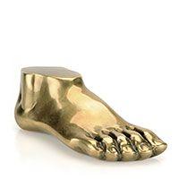 brass foot. paper weight, bookshelf object. want!