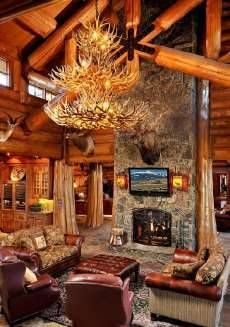 log home fireplaces LOVE the antler chandelier!! <3