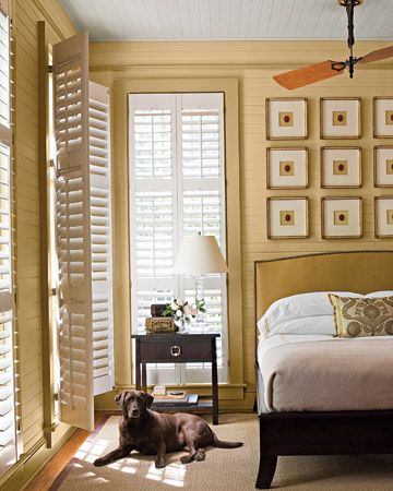 Who says windows need shades and curtains? These white shutters provide a clean and modern feel in this bedroom. (Martha Stewart Living)