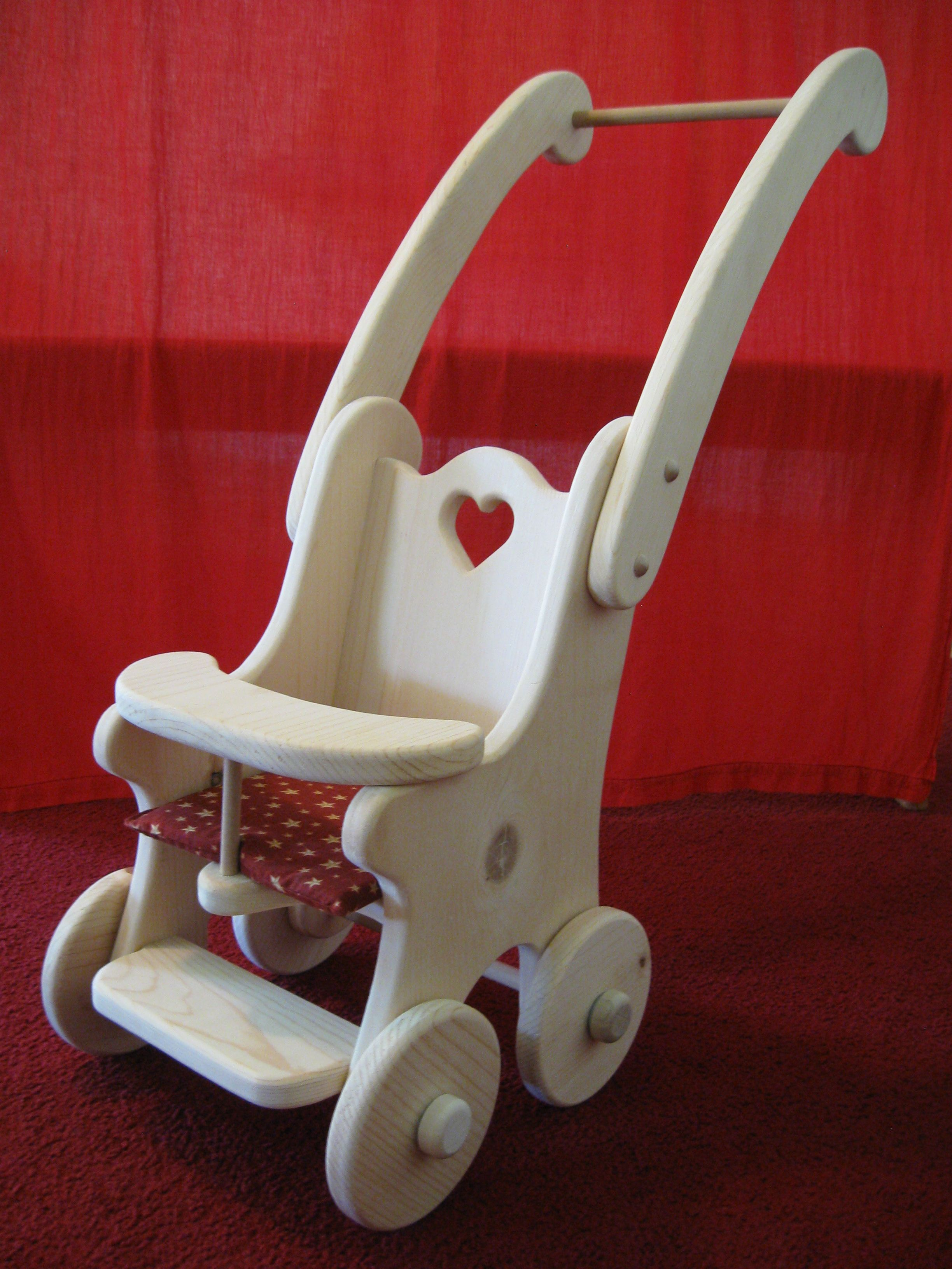 Waldorf Take dolly for a walk in this wooden stroller