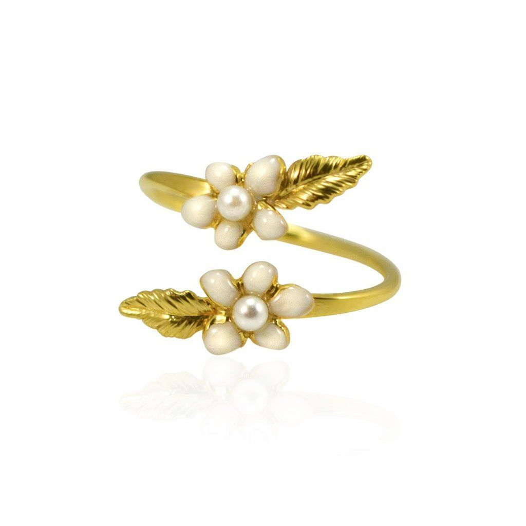 This white enamel flower ring accented with Swarovski pearls by Eric et  Lydie is so sweet
