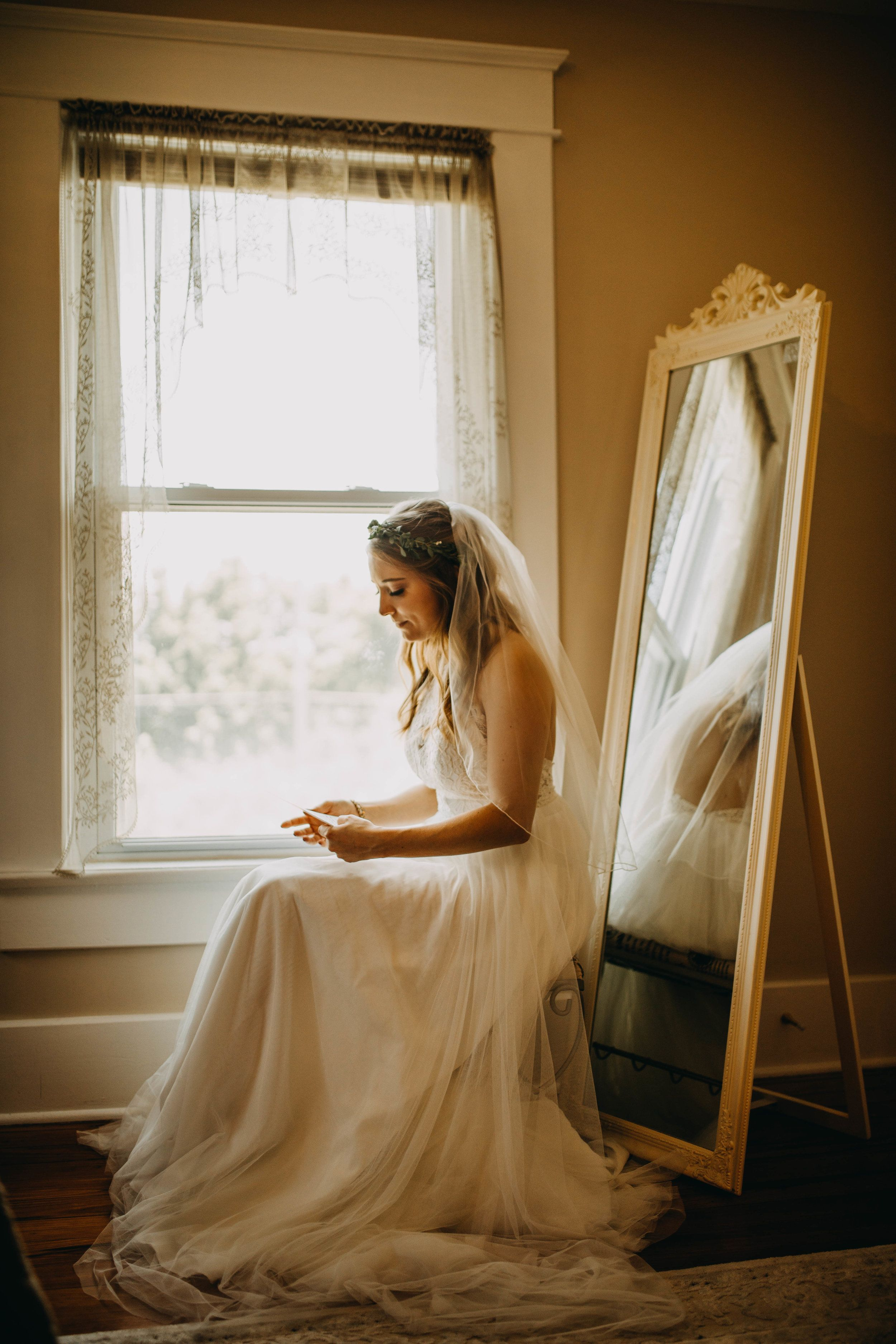 Bride reading letter from her love before the ceremony | The ...