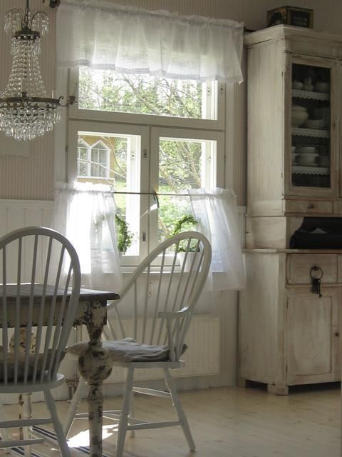 white cottage... love the sheer curtains and the primitive china cupboard