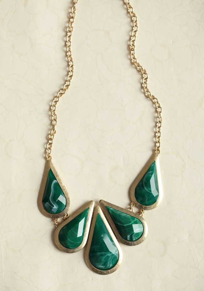 Art Nouveau Necklace In Green 18.99 at shopruche.com. Gorgeous faceted marbleized green teardrop stones adorn this artistic gold-toned necklace for a unique statement look.
