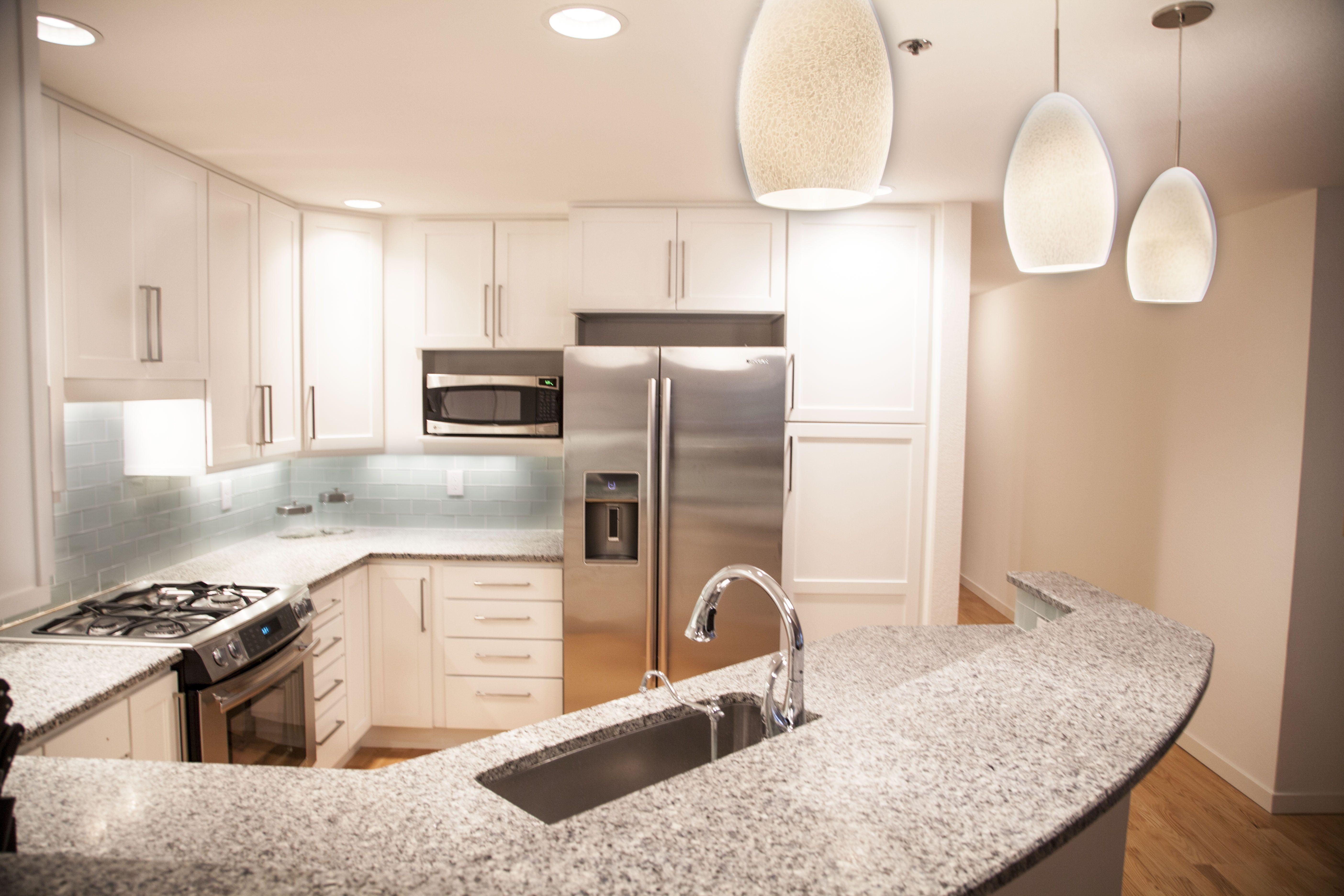 White Kitchen Cabinets Honed Salt And Pepper Granite White