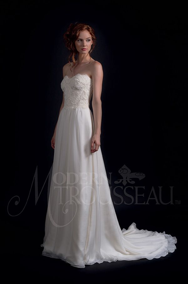 b001e492e6 Lutricately embroidered French lace corset bodice with a softly gathered  Italian chiffon skirt and chapel train.