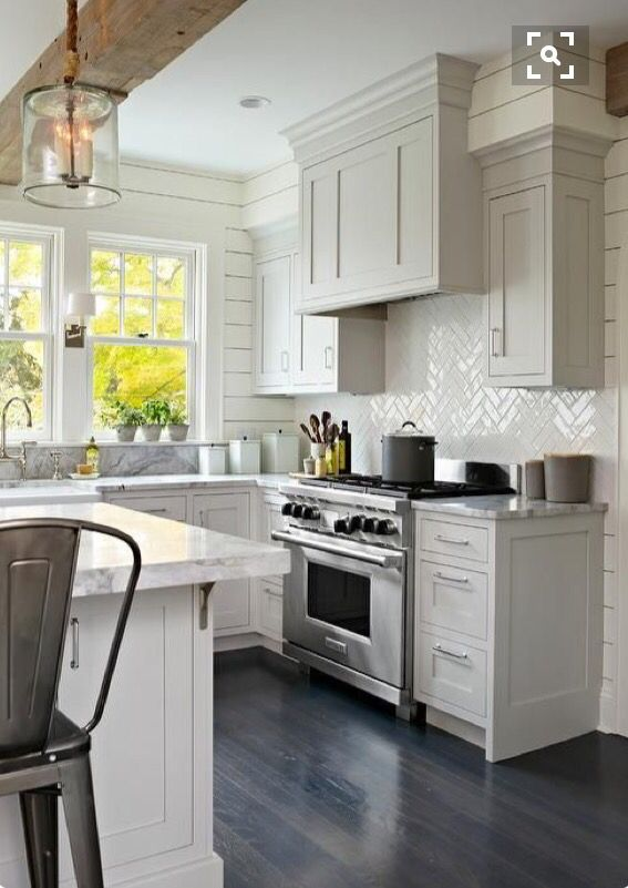Light Gray Shaker Kitchen Cabinets With Glossy White Herringbone Tile Backsplash Transitional Exposed Beam
