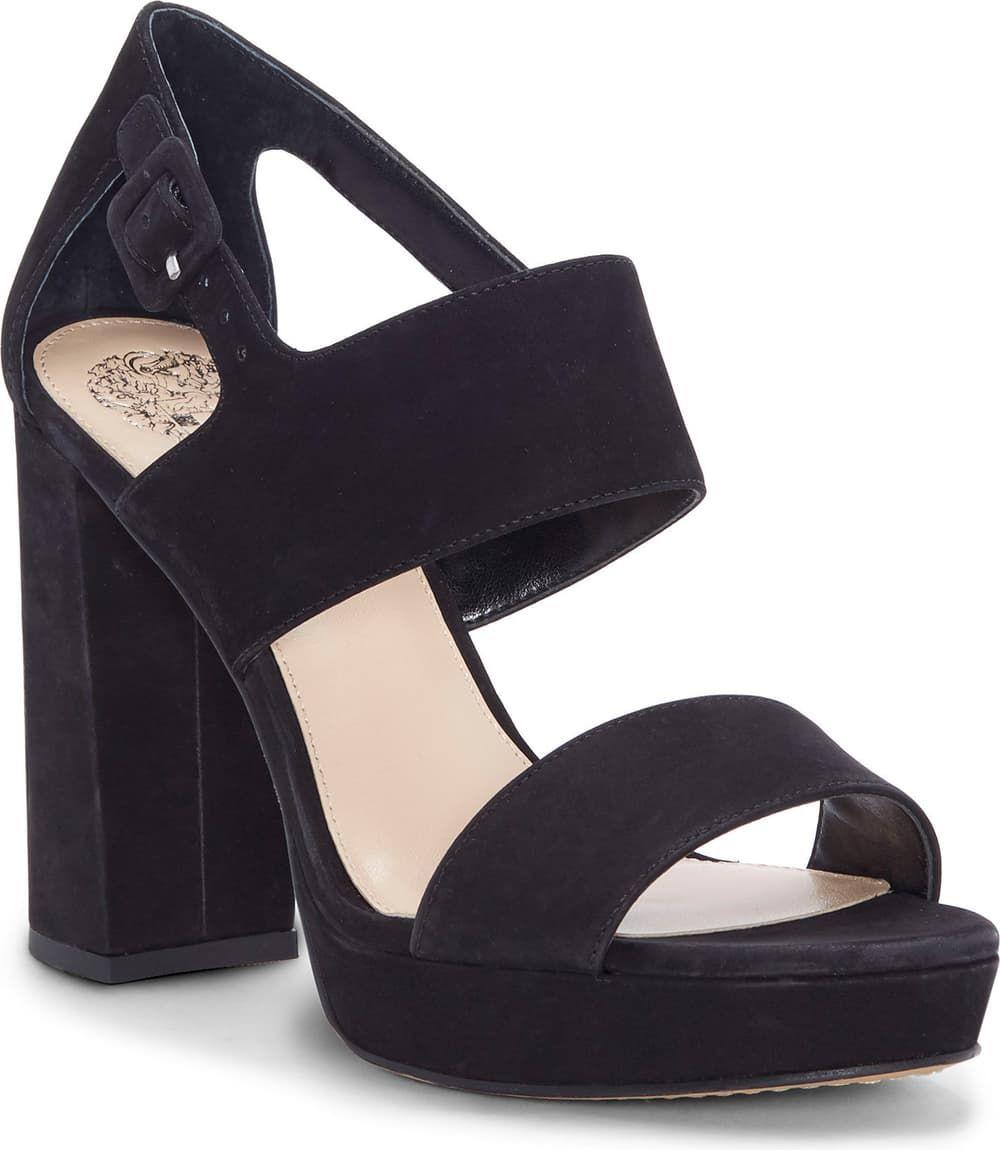 A lofty block heel extends the modern