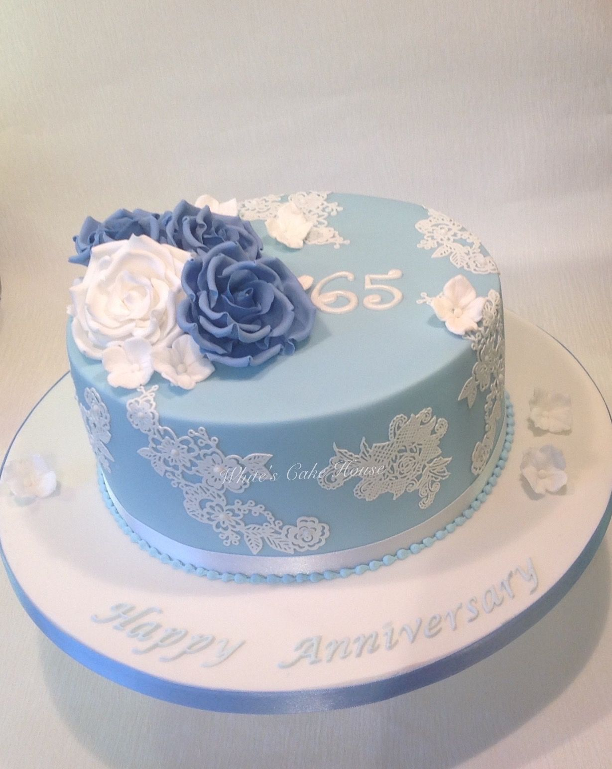Blue sapphire anniversary cake with roses Anniversary