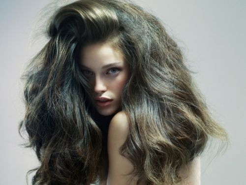 When it comes to BIG hair, just go for it. (As illustrated by Maybelline spokesmodel Emily DiDonato).